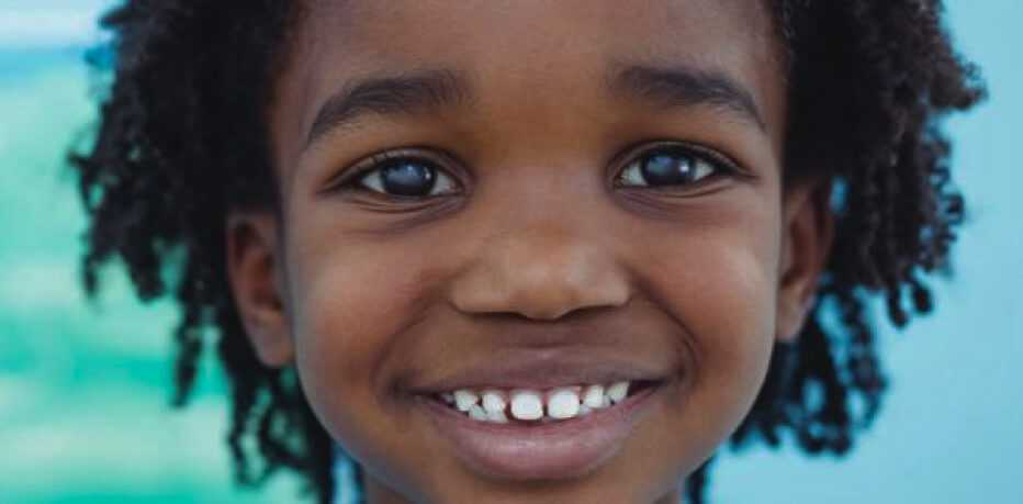 a child smiles for the camera