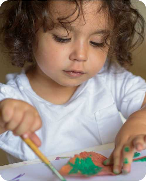 a child plays with paint